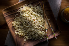 Asian Noodle with Chopsticks in a wooden plate. Stock Photo