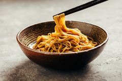 Asian noodle dish. With chopsticks. Soba noodles royalty free stock photo