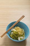 Asian noodle, egg noodle with boiled fish and spicy sauce. stree. T food in Thailand, : tomyam dried noodle Stock Image