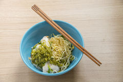 asian noodle, egg noodle with boiled fish and spicy sauce. stree Stock Photo