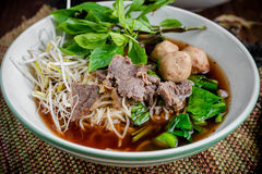 Asian noodle soup with beef meatball with fresh vegetable Royalty Free Stock Images