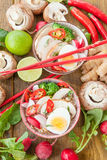 Asian noodle soup. Asian ramen noodle soup with fresh veggies and hardboiled egg Stock Images
