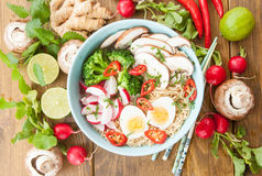 Asian noodle soup. Asian ramen noodle soup with fresh veggies and hardboiled egg Stock Photos