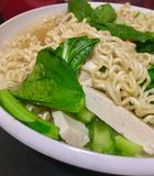 Asian noodle. Spinach green, tofu and noodle egg on white Royalty Free Stock Photo