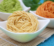 Asian noodles. Some colourful asian noodles for cooking a soup Stock Photo
