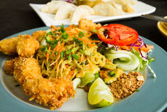 Asian noodles with chicken fried and salad. Stock Image