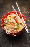 Asian noodles with chopstick, chicken and sprouts in red bowl Royalty Free Stock Photography
