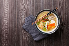 Asian noodles with egg, tofu and enoki Stock Photo
