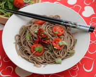Asian noodles. Some asian somen noodles with tomatoes and chili Royalty Free Stock Images