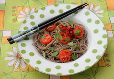 Asian noodles. Some asian somen noodles with tomatoes and chili stock photo
