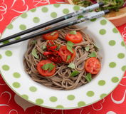 Asian noodles. Some asian somen noodles with tomatoes and chili royalty free stock photography