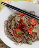 Asian noodles. Some asian somen noodles with tomatoes and chili Stock Image
