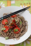 Asian noodles. Some asian somen noodles with tomatoes and chili stock images