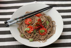 Asian noodles. Some asian somen noodles with tomatoes and chili Royalty Free Stock Photos