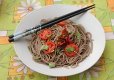 Asian noodles. Some asian somen noodles with tomatoes and chili Stock Photography