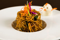 Asian Noodles. With vegetables on a white plate garnished with a vegetable decorated hard bolied egg Stock Images