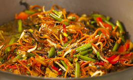 Asian noodles with vegetables on wok Royalty Free Stock Photography