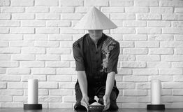 Asian novice on a white brick wall. Asian young novice on a white brick wall backgroundr stock image