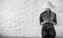 Asian novice on a white brick wall. Asian young novice on a white brick wall backgroundr royalty free stock image