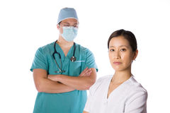 Asian nurse and doctor isolated against white Stock Image