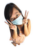 Asian nurse with mask acting cutely. Beautiful young Asian Woman nurse picture taken from the top to give a big doll head effect Stock Image