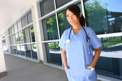 Asian nurse outside  hospital Stock Photo