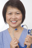 Asian Nurse with stethoscope Royalty Free Stock Photography