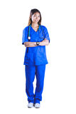 Asian nurse with stethoscope crossing arms Stock Image
