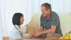 Asian nurse talking with her patient stock video