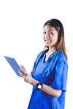 Asian nurse using tablet Royalty Free Stock Photos