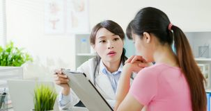 Asian doctor diagnoses patient stock photo