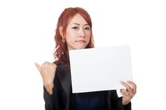 Asian office girl is in bad mood show a blank sign Stock Photography