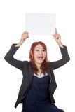 Asian office girl excited show a blank sign over her head Stock Photography