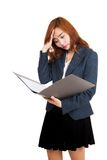 Asian office girl got headache with data in folder Stock Photography