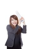 Asian office girl happy hold a roll of paper about to hit someth Stock Photography
