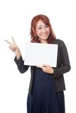 Asian office girl happy show a blank sign and victory sign with Royalty Free Stock Image
