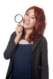 Asian office girl hold magnifying glass and smile Royalty Free Stock Image