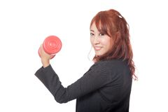 Asian office girl lift a red dumbbell and smile Royalty Free Stock Photo