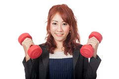 Asian office girl lift red dumbbells Royalty Free Stock Images