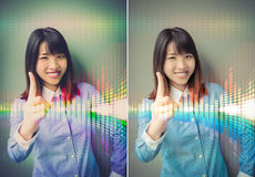 Asian office girl lifting her forefinger, showing for confidence Stock Photography