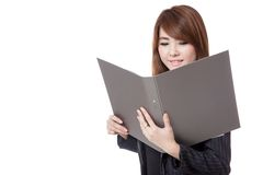Asian office girl  read data from folder and smile Stock Photos