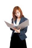 Asian office girl reading data in folder Stock Photography