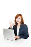 Asian office girl show OK sign with notebook PC Stock Photos