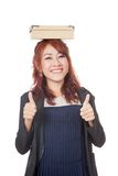 Asian office girl 2 thumbs up with a box on her head Royalty Free Stock Photo
