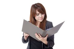 Asian office girl unhappy read data from folder Stock Images