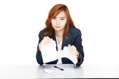 Asian office girl unhappy tear paper Stock Photography