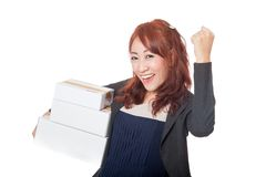 Asian office girl very happy with 3 boxes and fist pump Royalty Free Stock Photography