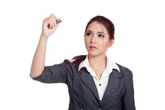 Asian office girl writing with a pen on air Royalty Free Stock Photos