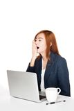 Asian office girl yawn while working Stock Photo