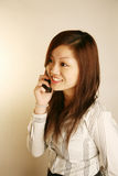 Asian office lady answer phone Stock Photo